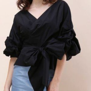 Enchanting Echo Wrapped Top in Black